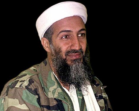 لادن تغسيله وقراءة القرآن عليه